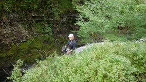 Woman Operating Drone in Forest