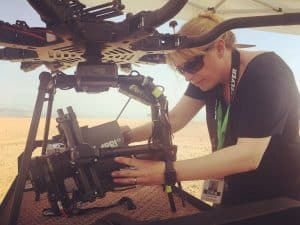 Woman Adjusting Camera and Drone