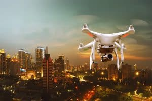 Drone Flying Above Lit City