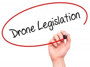 Man Writing Drone Legislation