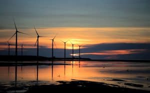 Wind Turbines in Sea Sunset