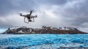 Drone Flying Above Iceberg