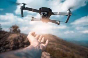 Drone Operator Launching Drone