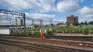 Railway Workers Stood on Traintrack