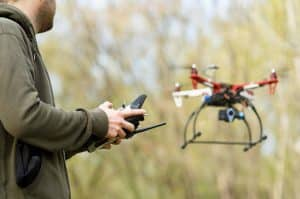Man Operating Drone in Forest