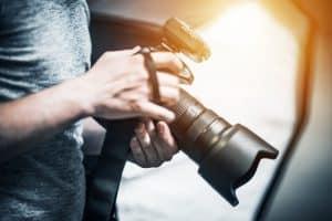 Man Holding Large Camera