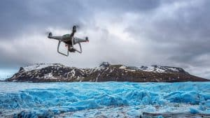 Drone Flying Above Iceberg