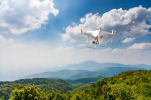 Drone Flying Over Green Mountains