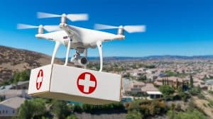 Drone Carrying Package Over Village