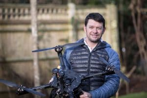 Man Holding Drone Smiling
