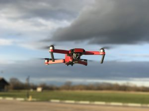 Small Drone Flying Over Runway
