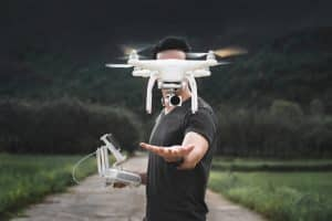 Man Releasing Drone in Air