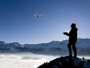 Drone Operator Flying Drone In Winter