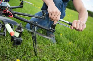 Man Adjusting Rotor on Drone