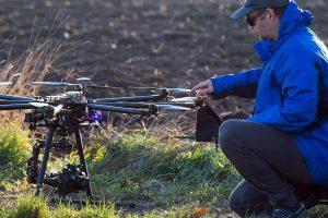 Drone Operator Adjusting Drone Propellers
