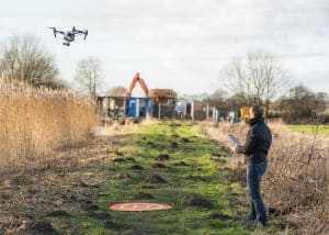 Man Operating Drone in Field