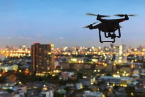 Drone Flying Over Lit City