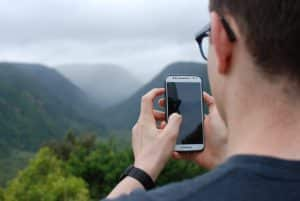 Man Taking Picture on Phone