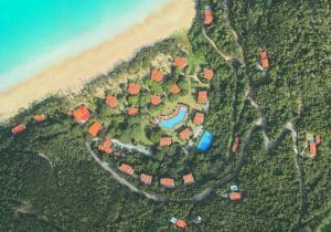 Aerial Photo of Houses by Sea