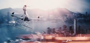 White Drone Flying Over City