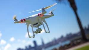 White Drone Flying in Sky