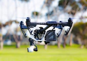 Drone Flying Over Grass