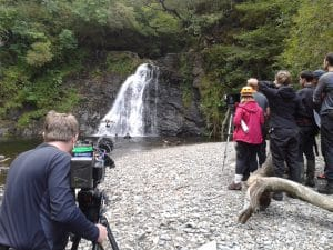 Film Crew Using Drone Waterfall