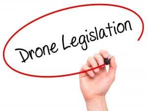 Man Writing Drone Legislation