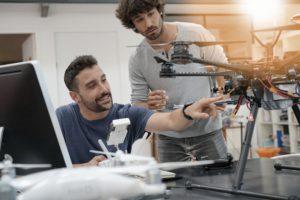 Drone Operators Inspecting Drone