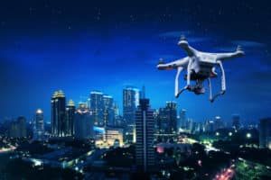 Small Drone Flying Over City
