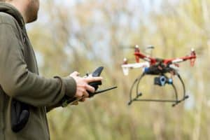 Man Flying Drone in Forest