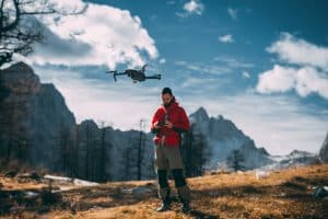 Photographer Flying Drone in Mountains