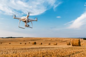 Drone Flying Over Yellow Field
