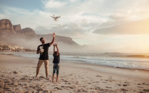 Drone Pilot & Child Flying Drone