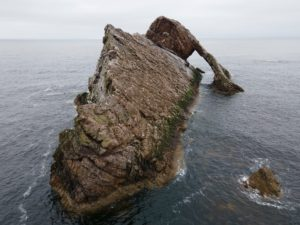 Natural sea arch the Bow Fiddle near Portknockie on the north-eastern coast of Scotland